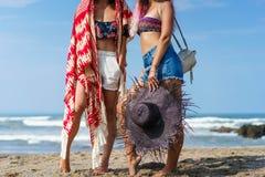 cropped shot of women in bikini standing together on beach stock photo