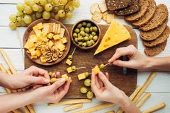 Women making canapes with cheese Royalty Free Stock Images