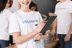 Female volunteer with clipboard Royalty Free Stock Images