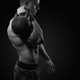 Cropped shot of young bodybulder holding a kettle bell Strong fitness male exercising crossfit with kettlebell in gym royalty free stock image