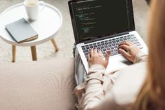 cropped shot of young female developer coding with laptop royalty free stock images