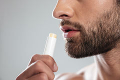 Cropped shot of young man with ?olorless lipstick. Cropped shot of young bearded man with ?olorless lipstick isolated Stock Images