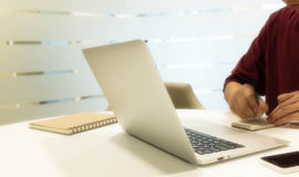 Cropped shot of a young man's hand moving while writing note wit Stock Photo