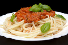 Cropped spaghetti ragu alla bolognese sauce on black Royalty Free Stock Photos