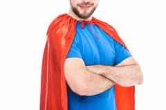 cropped strzał uśmiechnięty mężczyzna w bohater kostiumowej pozycji z krzyżować rękami obrazy stock