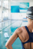 Cropped swimmer by the pool at leisure center Royalty Free Stock Photos