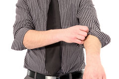 Man rolling up his shirt sleeves Royalty Free Stock Photography