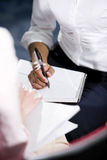 Cropped view of African American woman writing Stock Photography