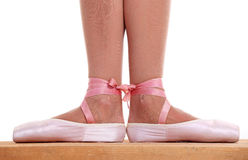 Cropped view of ballerina's feet in pointes Royalty Free Stock Photos