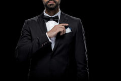 Cropped view of businessman in bow tie and tuxedo with napkin, Stock Image