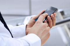 Cropped view of  Businessman holding the mobile  phone Stock Photos