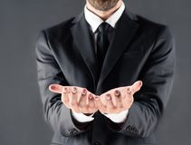 Cropped view of businessman with open hands