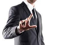 Cropped view of businessman in suit pointing with finger. Isolated on white Royalty Free Stock Photo