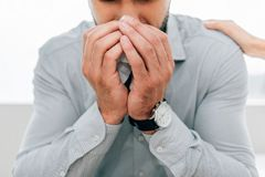 Cropped view of crying man. In psychologist office royalty free stock images