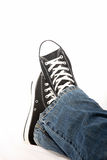 Person in jeans and sneakers Royalty Free Stock Images