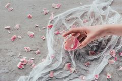 Cropped view of female hand with pink heart shaped soap. On white gauze on marble surface stock photography