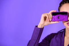 Cropped view of girl in purple jacket taking photo on camera, Stock Image