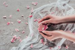 Cropped view of hands with pink heart shaped soap. On white gauze on marble surface Stock Photography