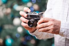 Cropped view of man holding retro camera Royalty Free Stock Photo