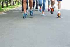 Cropped view of marathon athletes feet running. On the street Royalty Free Stock Photography