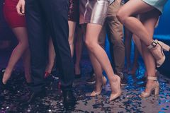 Cropped view of nice-looking glamorous stylish trendy adorable shine ladies and guys gentlemen legs dancing having fun. Cropped view of nice-looking glamorous stock photography