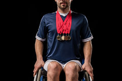 Cropped view of paralympic in wheelchair with gold medals on his neck Stock Image