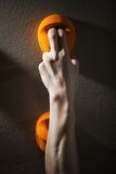 Cropped view of rock climber gripping handhold Stock Photo