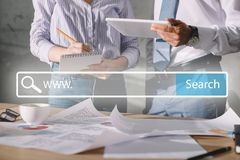 cropped view of seo managers working with documents and digital tablet with website search royalty free stock image