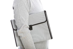 Man carrying a white briefcase. Cropped view of the torso of a man carrying a white briefcase under his arm standing sideways, isolated on white stock photo