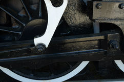 Cropped view of Wheel,sokes, gears on antique steam train engine Stock Images