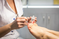 Cropped view of woman getting a pedicure at beauty salon Stock Photos