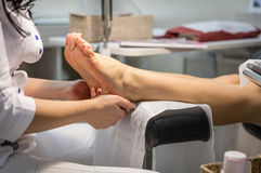 Cropped view of woman getting a pedicure and foot massage. Stock Photo