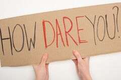 Cropped view of woman holding placard with how dare you lettering on white background, global warming concept