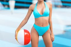 cropped view of woman in swimsuit posing with inflatable beach ball royalty free stock image