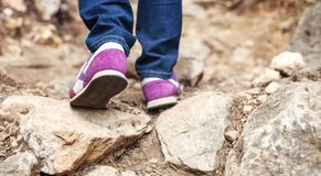 Cropped view of woman walking along trail Stock Image