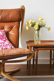 Cropped vintage tan leather chair with teak side tables Stock Photos