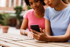 Croppped shot of two women sitting at restaurant Stock Photos