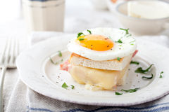 Croque madame, egg, ham, cheese sandwich. Traditional French cuisine. Stock Photos