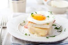 Croque madame, egg, ham, cheese sandwich. Traditional French cuisine. Croque madame, egg, ham, cheese sandwich with a cup of coffee. Traditional French cuisine Stock Photos