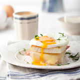 Croque madame, egg, ham, cheese sandwich. Traditional French cuisine. Croque madame, egg, ham, cheese sandwich with a cup of coffee. Traditional French cuisine Stock Photography