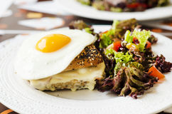 Croque madame- french breakfast. Special french sandwich- croque madame, with eggs, bacon and cheese Royalty Free Stock Photo