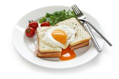 Croque madame , french ham and cheese sandwich wit. H fried egg , on white background Stock Photos