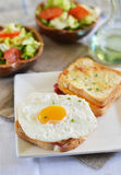 Croque-madame with green salad. Croque-monsieur with green salad on a white plate stock photos