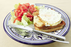 Croque madame plate with fried egg Stock Photo