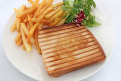 Croque-monsieur. Bread tart on a white background Stock Photos
