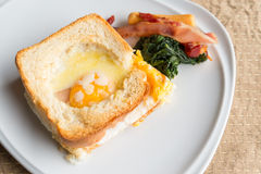 Croque monsieur or egg ham cheese sandwich with garnish Stock Photos