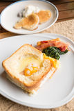 Croque monsieur or egg ham cheese sandwich with garnish Royalty Free Stock Image
