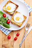 Croque monsieur with eggs on vintage table Stock Photos