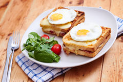 Croque monsieur with eggs Stock Photos
