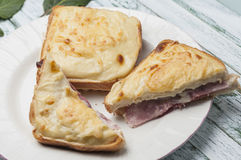 Croque-monsieur. Sandwich bread with grated cheese bechamel and ham recipe cooked French croque-monsieur Royalty Free Stock Photo